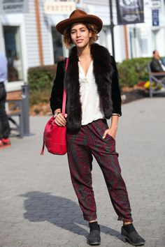 13 Street Style Outfits You Should Copy This Week #refinery29  http://www.refinery29.com/woodbury-common-mall-premium-outlets#slide-1  Host Christina Caradona from Trop Rouge masters low-key weekend style in a fur topper, easy trousers, and a slouchy red bag for a playful touch.