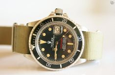 """Rolex """"Red"""" Submariner ref 1680 on a NATO strap."""
