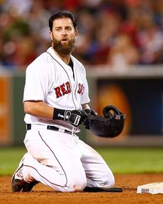 BOSTON, MA - AUGUST 16: Mike Napoli #12 of the Boston Red Sox reacts after sliding into a double play against the Houston Astros during the game at Fenway Park on August 16, 2014 in Boston, Massachusetts. (Photo by Jared Wickerham/Getty Images)