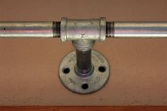 Industrial Pipe Curtain Rods   ... an extra support and allowed us to use two shorter lengths of pipe