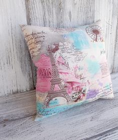 Paris pillow cushion, blue and pink French vintage travel theme fabric, maps and postcards. $18.90, via Etsy.