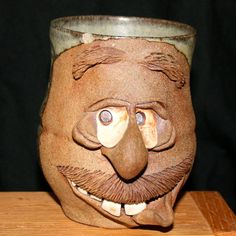 Pottery   stoneware pottery face mug.