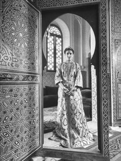 Princess Lal-la Fatima of French Morocco posing in her ceremonial dress  during a pre-wedding trip to the palace for her marriage to Muley el  Hassan, Caliph of Spanish Morocco. Photograph by Dmitri Kessel. Morocco, June 1949.