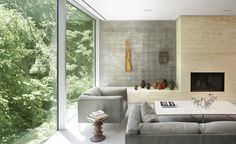 Poured-in-situ concrete is accompanied by oak millwork, a travertine fireplace and a soft white plaster exterior. Concrete House, Toronto by Angela Tsementzis. Residential Architecture, Interior Architecture, Concrete Architecture, Architecture Wallpaper, Concrete Houses, Interior Decorating, Interior Design, Home Wallpaper, Wallpaper Magazine