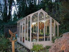 A Nantucket style greenhouse located on Vashon Island Washington  I will definitely have white lights in my greenhouse :)
