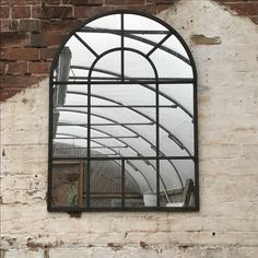 Garden Mirror in glasshouse