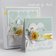 handmade wedding card and box (to hold it!) ...  dusty aqua, white, bright yellow ... luv the focal point yellow paper rose ,,, montage of flowers, foliage, hat pin ... aqua paper sewn to card base ..,. fishtail banners ,,, die cut hearts ... love the heart pattern on the box ... delightful set!!