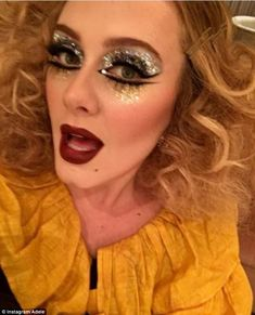 Mane attraction: Appearing as a glamorous clown, the Hello hitmaker worked her flame-haired locks into a messy curl which she teased for extra volume