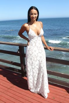 Draya Michele posed for the cameras in Malibu, wearing a $410 Contessa Los Angeles White Lorenza Long Dress: Her lace dress features a maxi length and deep neckline. Great dress! Get Draya's dress here. Are you feeling it?