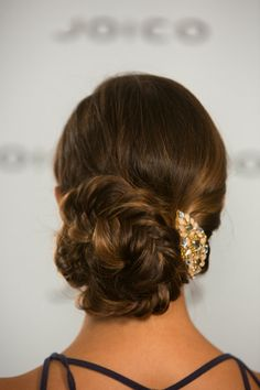 HOLIDAY DINNER PARTY #HAIRSTYLE: Fishtail braids-meet-the-classic-chignon with this uber-elegant up-do that feels fanciful enough for elegant dining. #holiday #holidayhair #TurnHeads