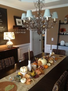 30 Amazing And Cozy Fall Dining Room Décor Ideas : Fall Dining Room Décor With White Brown Walls Chandelier Wooden Table Chair Stool Lamp Door Cabinet Pumpkin Ornament