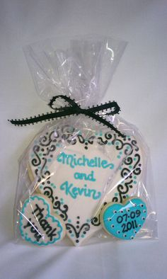 Wedding cookie favors @Jamie Mcgauhey  Something like this, but obviously not written on the cookie. Probably a printed out tag.