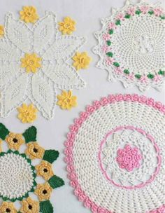 Crochet Patterns for Vintage Floral Doilies: Set 1My Crochet Design Inspiration: Crochet Patterns that make delicate crocheted doilies delight me. On my excursions to the various vintage shows around the country, I've picked up some beautiful crochet pieces. The vintage floral doilies in this set were all found at different shows. Each one