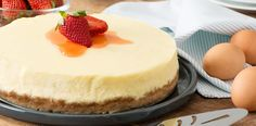 Cheesecake is a popular dessert for its decadence, richness, and myriad varieties. With a hint of vanilla and a graham cracker crust, this classic cheesecake recipe keeps things simple yet elegant. Cheesecake Original, Plain Cheesecake, Classic Cheesecake, Simple Cheesecake Recipe With Sour Cream, Strawberry Cheesecake, Honey Recipes, Baking Recipes, No Bake Desserts, Dessert Recipes