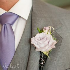 Light Purple Rose Boutonniere // photo: Liga Photography // boutonniere: Flourish Fresh Productions Inc // Wedding: http://www.theknot.com/weddings/album/a-pastel-wedding-in-orlando-fl-110277