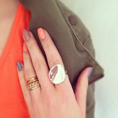 Ring finger: Tri-tone set of three rings (broken up), Pave link stack ring in gold; Pointer: Oversized smooth metal ring in silver http://kellywilliams.chloeandisabel.com/