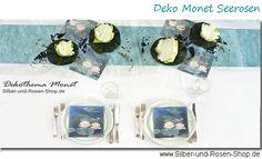 Tischdeko mit Elementen aus Monets Seerosenbildern.