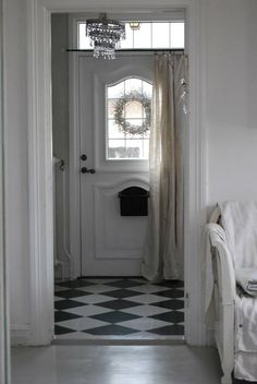 GARDEN STYLE LIVING - love the black & white floor, the chandelier, and the door curtain!