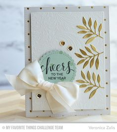 cheers to the new year card by veronica zalis featuring the hand lettered holiday stamp set garden flourish background stamp and leafy greenery and