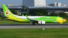 Nok Air (TH) Boeing 737-86J HS-DBR aircraft, named ''Nok Yoknapha'', skating at Thailand Bangkok Don Muang International Airport. 04/11/2015.