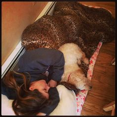 Sleeping with her lovely dog.