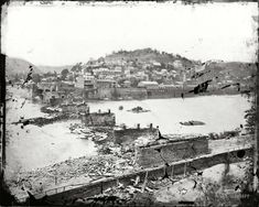 """""""Harpers Ferry, West Virginia. View of town; confluence of Potomac and Shenandoah rivers; railroad bridge in ruins."""" Battle of Harpers Ferry, September 1862."""