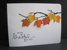 By Lisa A. Memory Box branch die-cut. Martha Stewart maple leaf punch. Punch watercolor paper leaves; paint with Distress inks: fired brick, orange marmalade, and mustard seed. Attach branch to white linen cardstock base. Pop up leaves. Add sentiment.