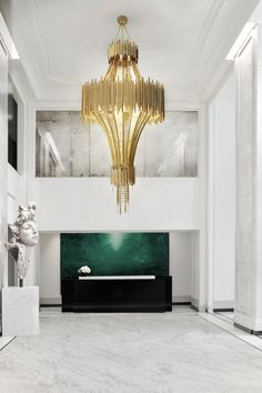 A modern chandelier by Luxxu | Modern Lamps #luxuryhomes #interiordesign #homedesign - Dream Homes