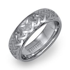 For my guy - Triton wedding band with lased Celtic pattern.