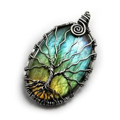 Stunningly beautiful tree of life pendant and necklace made of solid .925 sterling silver that is carefully wrapped around a flashy, multi colored Labradorite gemstone to form the ancient tree of life design. These pendants are perfect for wearing all day everyday and seem to just fit into any wardrobe. They are also elegant enough to wear out on special occasions or for business.    Labradorite colors and lighting:    Labradorite is a gem that changes color when it comes in contact with…