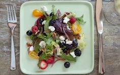 whole foods berry goat cheese salad:  red onion, walnuts, grape tomatoes, mixed berries, feta cheese