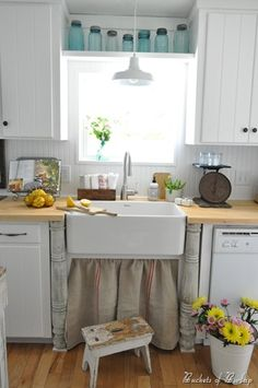 Love this! We could do a shelf above the kitchen window too. Also the wood countertops, white cupboards.