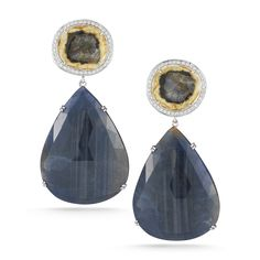 One Of A Kind Courtney Lauren Rough-cut natural yellow sapphire studs with 0.62 carat diamond halo and blue sapphire teardrop set in 14k white gold boast a stunning earring with earthly elegance.