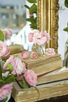 roses, books and gilt-edged mirrors