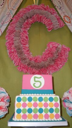 DIY Monogrammed letter made of cupcake liners.  Use as a wreath or decoration for shower or kids birthday party.