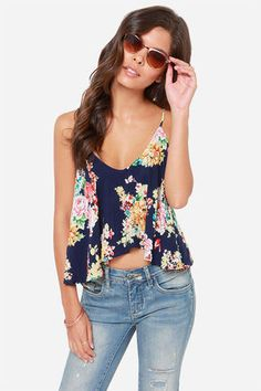 "Top your high-waisted shorts and strappy sandals with the Fashion Flow-ard Navy Floral Print Tank Top, and everything else will fall right into place! Woven navy blue fabric features a colorful floral print with pops of pink, red, and goldenrod. Long spaghetti straps crisscross at back, supporting a breezy cropped length bodice that falls into ripples all around. Fully lined. Model is 5'7"" and is wearing a size small. 100% Rayon. Hand Wash Cold. Imported."