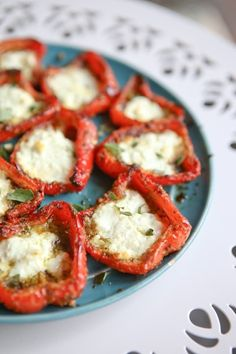 A simple, yet impressive, side dish or appetizer - roasted red peppers with pesto and goat cheese are full of flavor and a delicious addition to any meal.