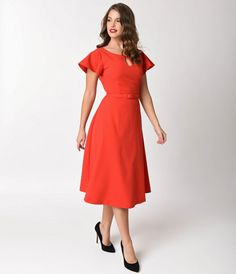 Sizzle in this hot commodity, dear! A body hugging red swing dress from Vintage Diva by Top Vintage crafted in a sleek 1940s inspired silhouette with supple high quality stretch knit composition that fits beautifully to your figure. This modest piece feat