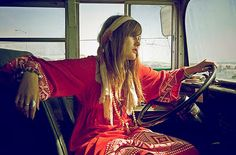 hippie girl driving a bus