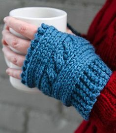 Free Knitting Pattern for Easy Cabled Hand Warmers - These fingerless mitts are knit flat in bulky yarn. Great first cable project. Rated very easy by Ravelrers. Designed by by Kirsten Hipsky for Valley Yarns.