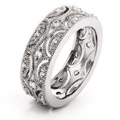 Get old fashioned elegance with this Victorian Style Wedding Band. This beautiful sterling silver wedding band is 1/3 inch wide and holds a lovely intricate vintage style design of 1 mm and 2 mm diamond cubic zirconias. This ring makes a lovely casual accessory or a unique choice of wedding ring!