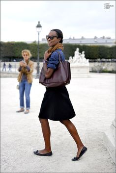 love her bag, her skin color, her hair style, her glasses and skirt