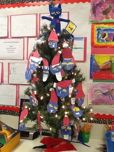 We read Pete The Cat Saves Christmas and made a pete The Cat Christmas Tree.