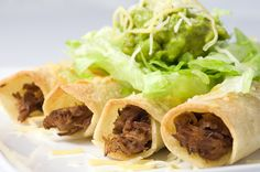 Baked Beef Taquitos - I would subsitute some queso fresco for the cheddar cheese and put it inside the taquito. If you layer cheese then beef, the cheese won't leak out when you cook them. I also like flour tortillas better than corn.