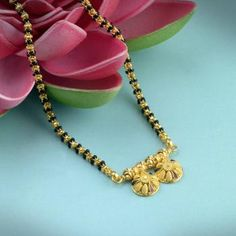 Explore the trendy collection of Gold Mangalsutra design at Waman Hari Pethe Sons. Beaded Jewelry Designs, Gold Earrings Designs, Necklace Designs, Gold Bangles Design, Gold Jewellery Design, Gold Jewelry, Gold Necklace, Gold Mangalsutra Designs, Diamond Mangalsutra