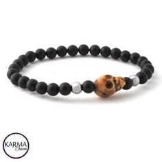 Matte Onyx and Hematite beads (6mm) with a hand carved bone Tibetan skull.  #bracelets #mensfashion #mensjewelry #johnnydepp #instajewelry #hipster #handmade #handmadejewelry #skull #sonsofanarchy #charliehunnam #gypsies #reincarnation #rockabilly #armcandy #oneofakind #herenarmbanden #dappermen #jewelrydesign #jewelryaddict #favehandmade #karmacharms #armbanden #rebel #semiprecious #gemstones #barber I think this bracelet would look great on mr @charliematthewhunnam himself!
