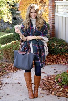 Tartan blanket poncho + chunky knit ivory turtleneck + dark skinny jeans + cognac leather boots
