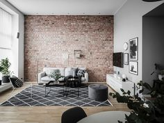 Scandinavian living room with exposed brick wall