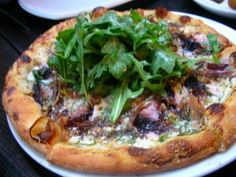 Pizza Topped with Ham, Figs, Goat Cheese and Arugula