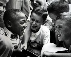 Newly Integrated Friends (1954)    This photo was taken less than four months after the Brown vs. Board of Education decision. Public schools in Baltimore opened with black and white students in the same classrooms.    Charles Thompson, the only black pupil at Public School No. 27, is greeted by his new classmates (names unknown).    Dick Stacks Photographer/Baltimore City Library